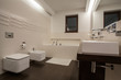 Travertine house - well-designed bathroom