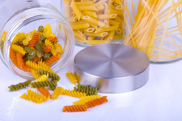 Delicious Colorful Pasta in Glass Jar on white