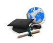 Graduation hat, diploma and globe