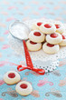 Homemade almond cookies filled with jam, selective focus