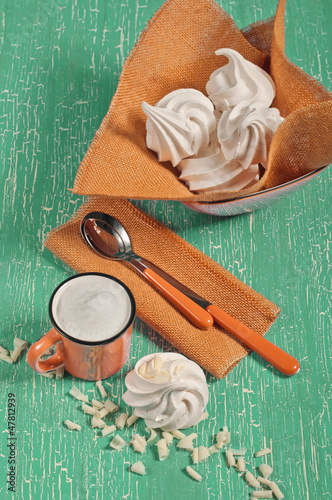 Meringues and cup of milk