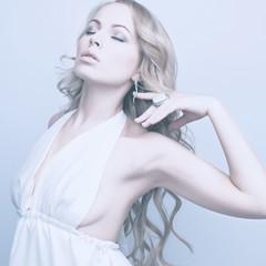 beautiful elegant blond woman in white dress