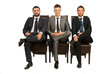 Elegant business men sitting chairs