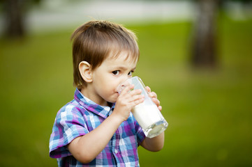 little boy with glass of milk