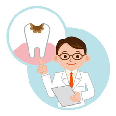 虫歯の説明をする歯科医