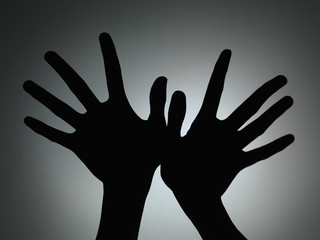 two hands silhouette