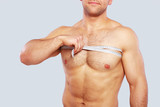 Close up of man measuring his chest poster