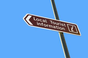 tourist information sign on blue sky