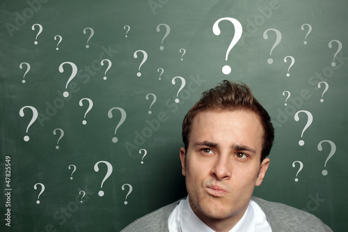 Man at the Blackboard with Questionmarks