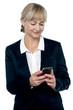 Entrepreneur reading message on her mobile