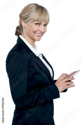 Female executive operating touch screen cellphone
