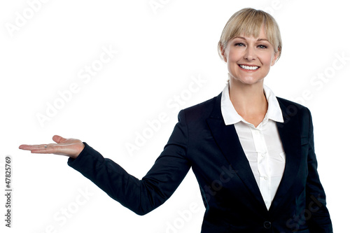 Cheerful business executive presenting copy space area