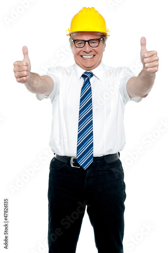 Business architect showing double thumbs up