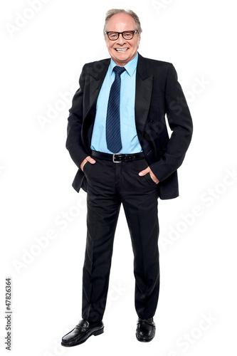 Happy entrepreneur striking a confident pose