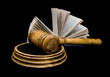 gavel and book on a black background closeup