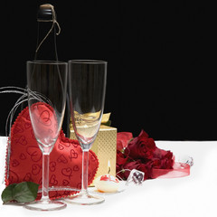 Romantic still life with fruit sparkling wine,gift and roses
