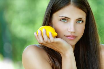 young woman with yellow lemon