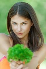 beautiful young woman with parsley