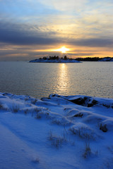 Cold winter evening seascape with sunset