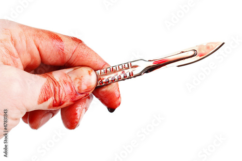 Bloody hand with sharp surgeon scalpel , isolated