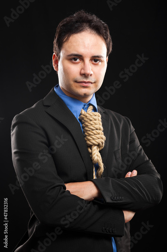 Businessman with a rope around neck, tax pressure concept