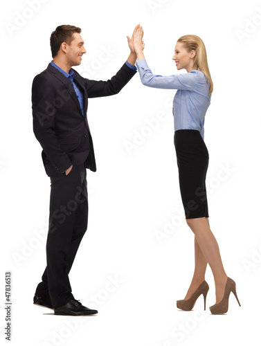 man and woman giving a high five