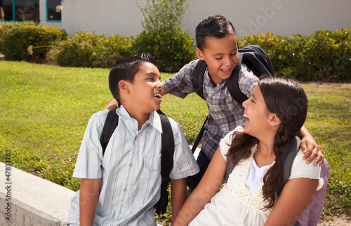 Cute Brothers and Sister Talking, Ready for School