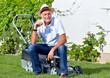 Senior man take a break after cuting the grass