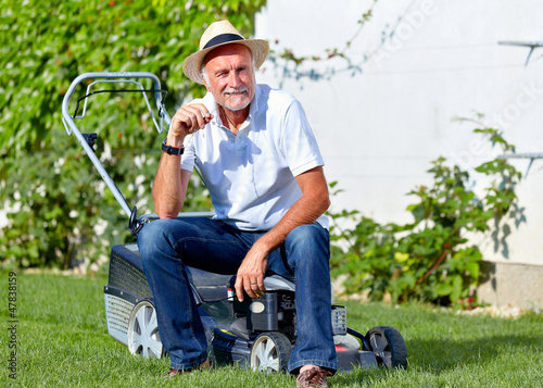 Senior man take a break after cuting the grass