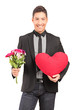 A young stylish guy holding a bunch of flowers and heart