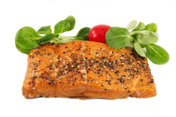 A peace of smoked spiced salmon with vegetables