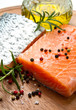 Fresh salmon fillet on wooden board