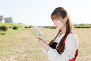 Beautiful asian woman relaxing in nature