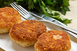 Chicken cutlets on white plate