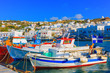 Colorful wooden fishing boats on row  Mykonos island old port Gr