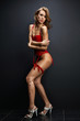 Attractive young woman in red sexual lingerie