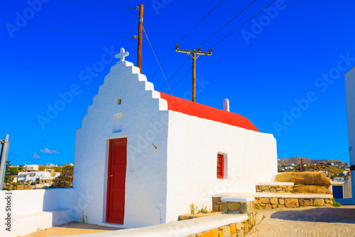 Staande foto Athene Traditional Red Church in Mykonos Island Greece Cyclades