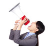 Business woman angry screaming loudly in a megaphone