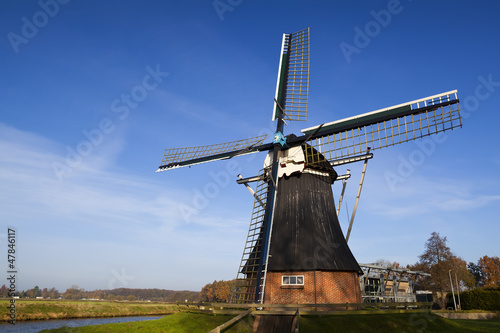 Dutch windmill over blue sky