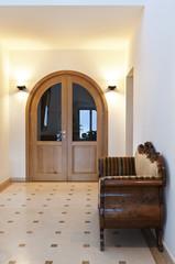 beautiful apartment, interior, corridor with antique sofa