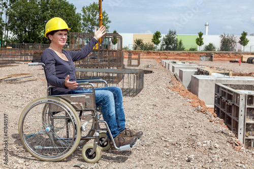 Engineer in a wheelchair on site