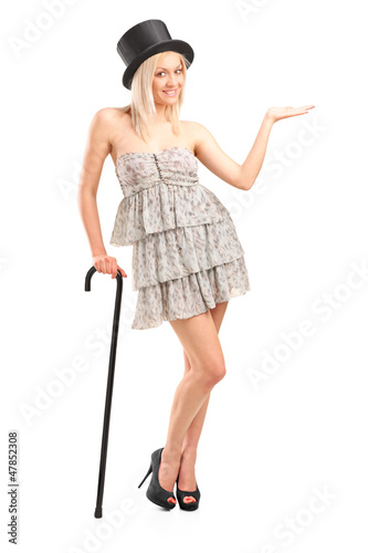 Blond woman holding cane and gesturing