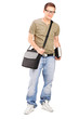 Male student with shoulder bag holding a book
