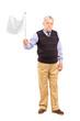 Sad senior man waving a white flag