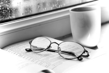 Glasses, book and cup of coffee