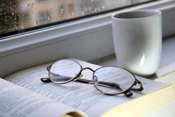 Glasses, book and coffee