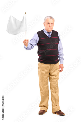 Sad senior man waving a white flag