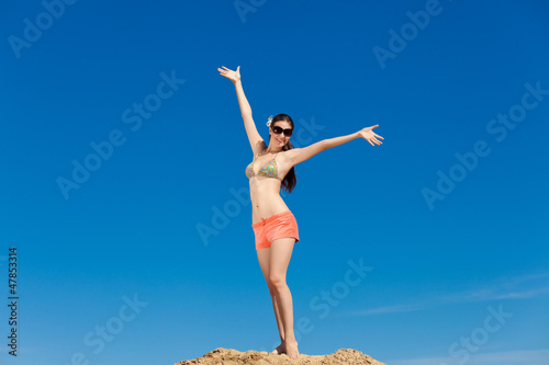 Portrait of young woman in bikini at beach