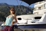 Young beautiful girl near the yacht