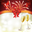 Champagne glasses and two with bow and fireworks